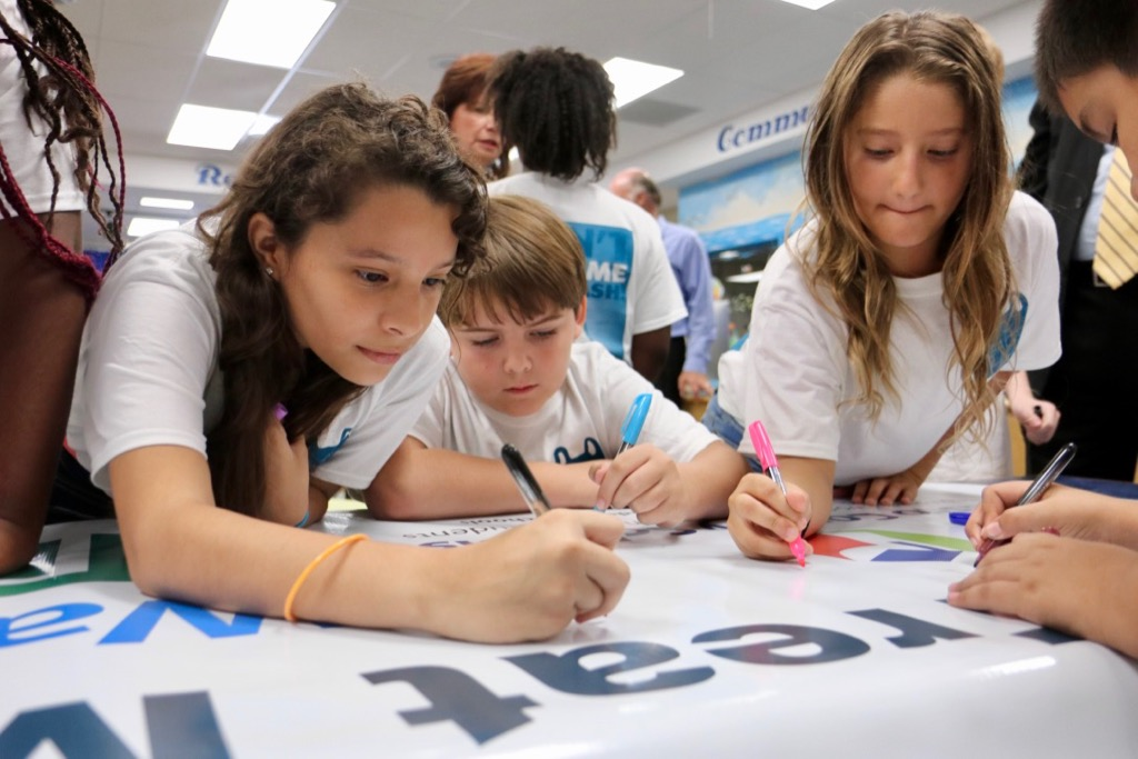 Gulf Trace Elementary students sign the A Bag's Life banner to kick off our plastic bag recycling challenge.
