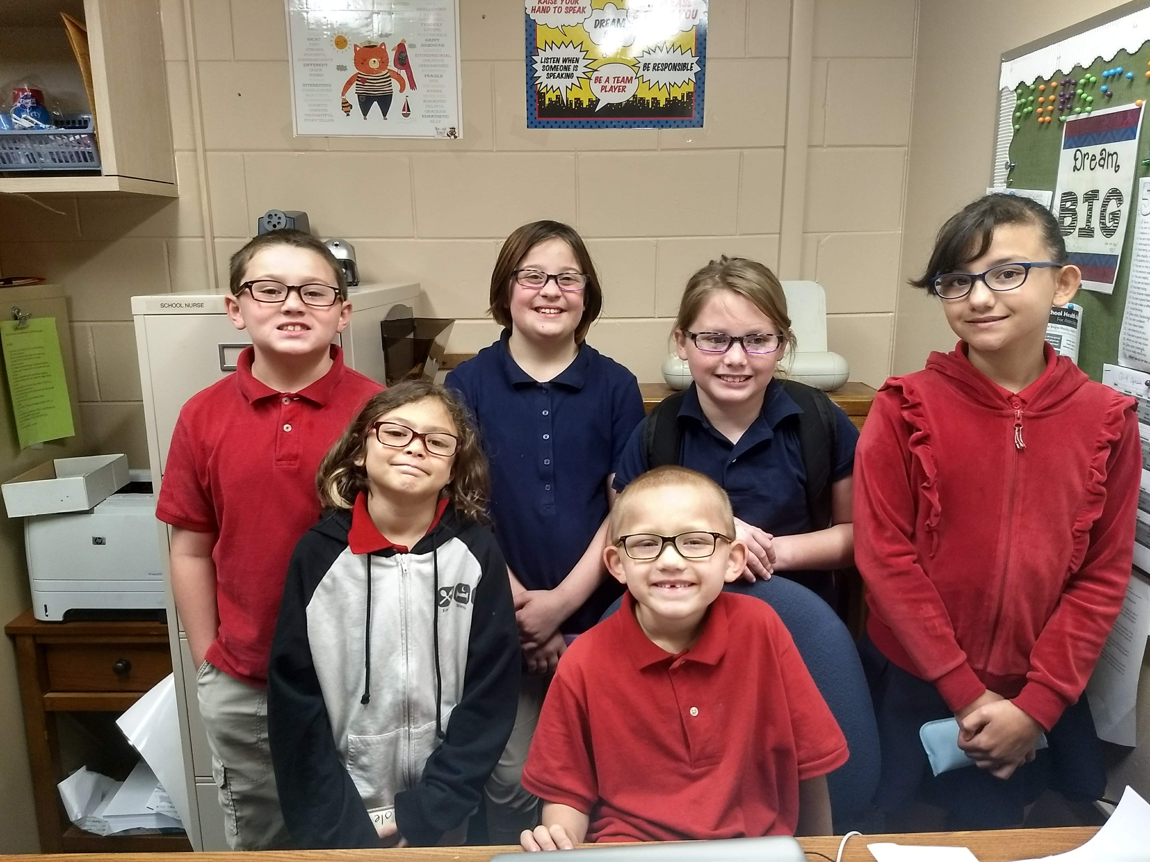 Hudson Elementary students show off the new eye glasses they received at no cost from the Florida Vision Quest vision van.