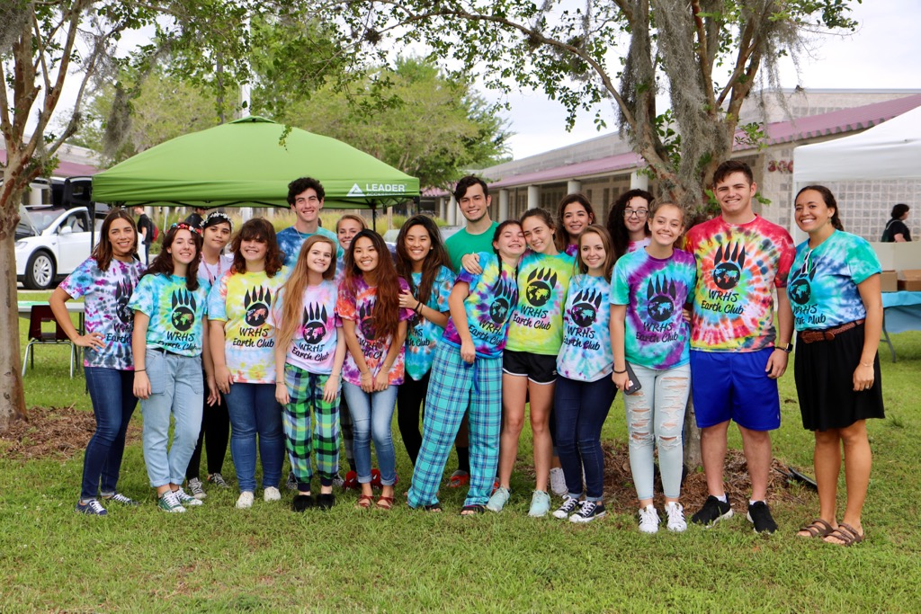 The Wiregrass Ranch High Earth Club posing for a photo during their Earth Day event.