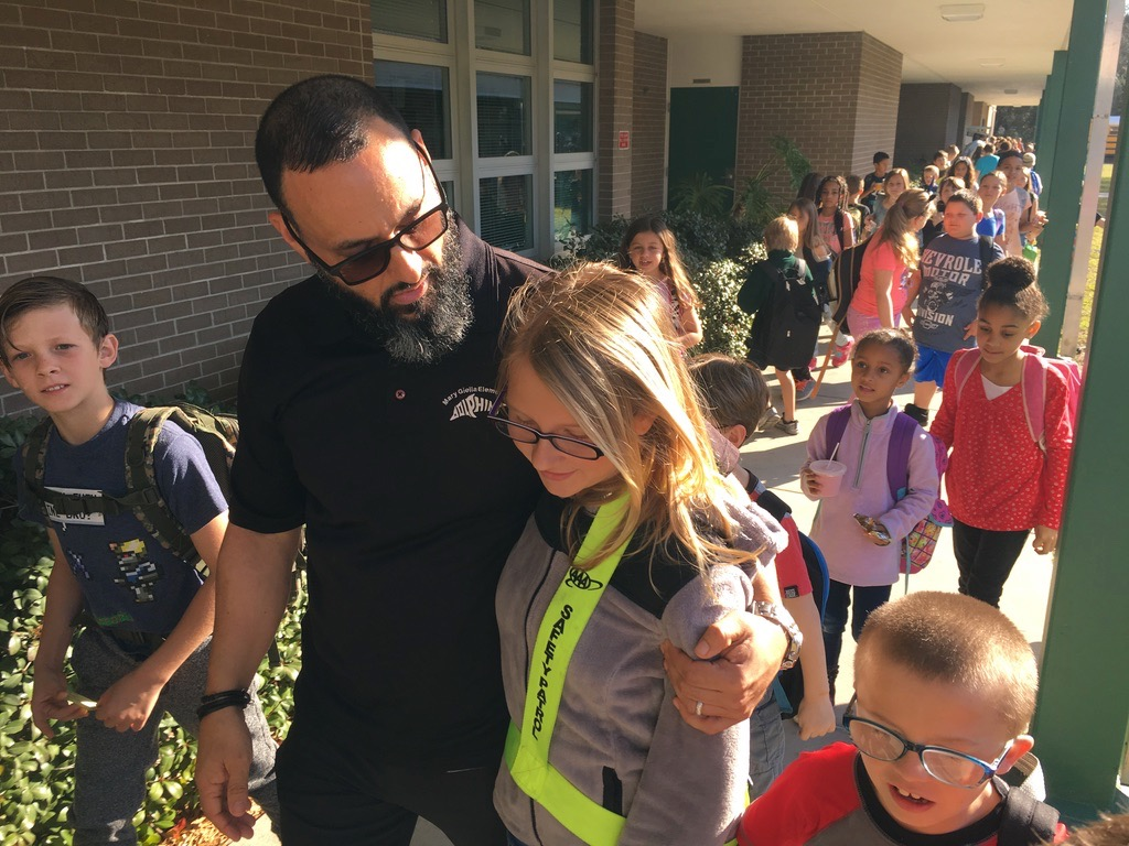 A Mary Giella Elementary student is happy to see her former principal, Mr. Papa