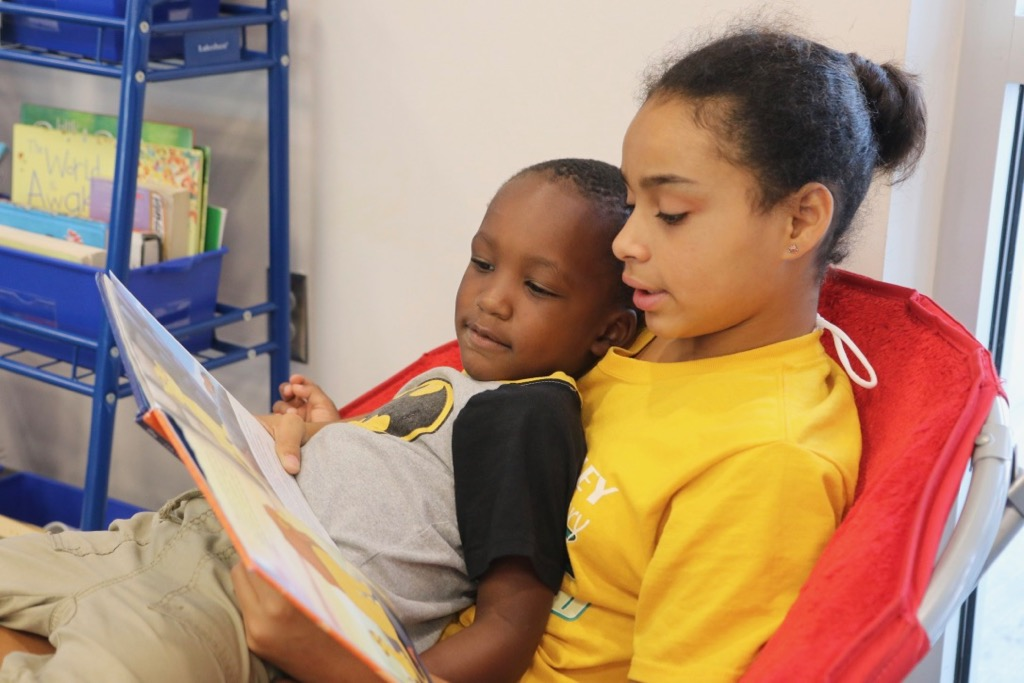 Students reading a book together at Woodland Elementary School.